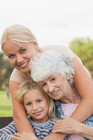 three generations of women: Three generations of women portrait sitting on a park bench