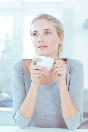 thoughful: Thoughful woman drinking a cup of tea LANG_EVOIMAGES