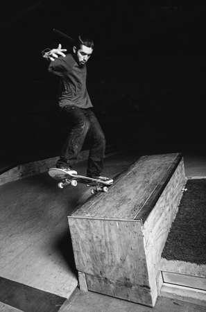impressive: Skater doing impressive backside grind down hubba ledge in skate park LANG_EVOIMAGES