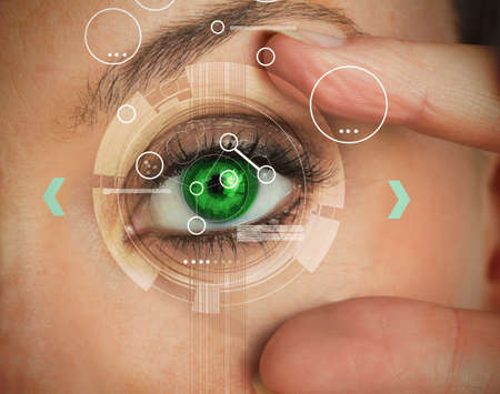 identifying: Woman stretching her green eye for an authentication LANG_EVOIMAGES
