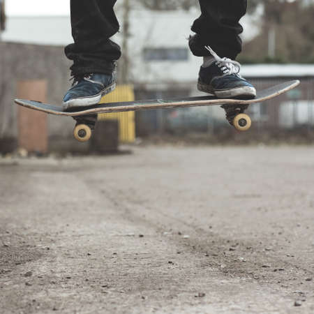 skaters: Skaters feet on board mid air doing ollie trick outside LANG_EVOIMAGES