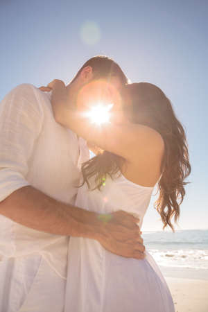 short wave: Romantic couple kissing on the beach
