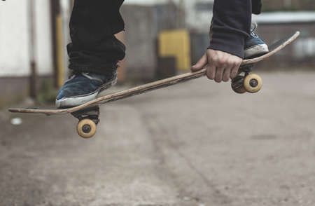 grabbing: Skater grabbing his board mid air outside the skate park