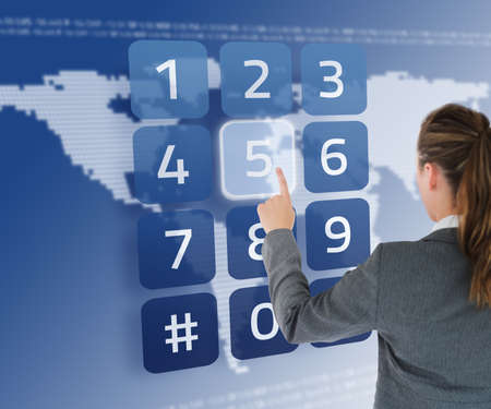 the entering: Businesswoman entering pin on digital keypad on world map background in blue
