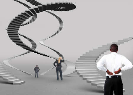 deciding: Business people deciding which career route to take on grey background LANG_EVOIMAGES
