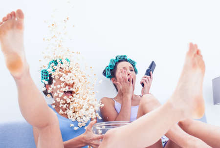 they are watching: Friends with exploding popcorn while they are watching a movie
