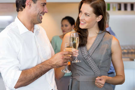champagne flutes: Business colleagues toasting champagne flutes in the office LANG_EVOIMAGES