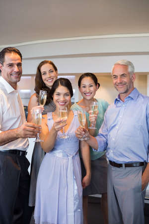 champagne flutes: Portrait of happy people holding champagne flutes
