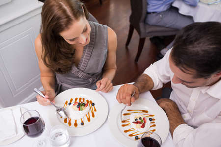 couple dining: High angle view of a young couple dining in the restaurant