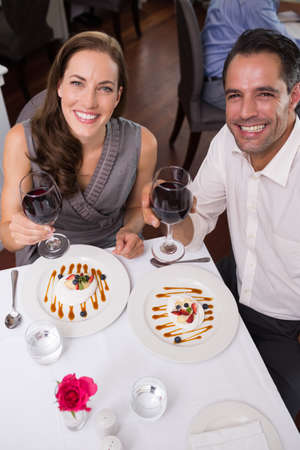restaurant dining: High angle portrait of a young couple with wine glasses dining in the restaurant
