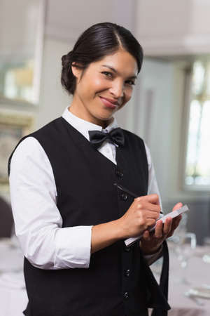order in: Pretty waitress taking an order in a fancy restaurant