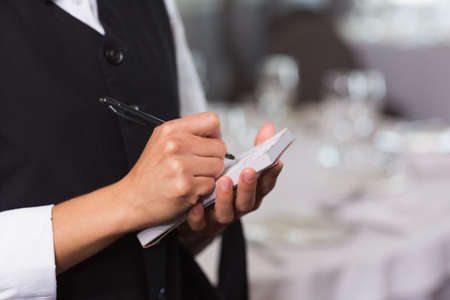 order in: Waitress taking an order in a fancy restaurant LANG_EVOIMAGES