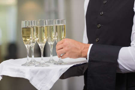silver flute: Waiter holding tray of champagne in a fancy restaurant