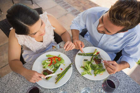 dinner date: Happy couple on a dinner date in patio of restaurant