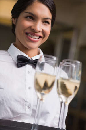 silver flute: Pretty waitress holding a tray of champagne in a fancy restaurant