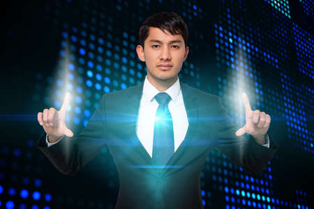 serious businessman: Digital composite of serious businessman touching lights