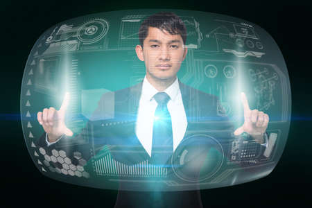 serious businessman: Digital composite of serious businessman touching interface