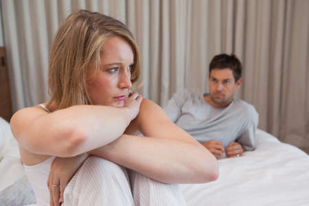 not talking: Unhappy couple not talking after an argument in bed at home