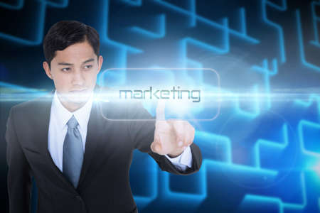 unsmiling: The word marketing and unsmiling asian businessman pointing against shiny lines on black background LANG_EVOIMAGES