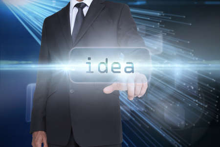 against abstract: The word idea and businessman pointing against abstract technology background