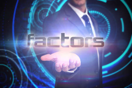 factors: The word factors and businessman presenting against futuristic technological background
