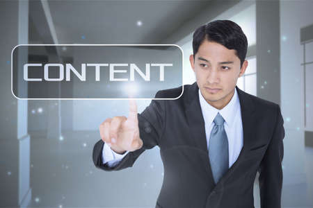 unsmiling: The word content and unsmiling asian businessman pointing against screen in room with sparks