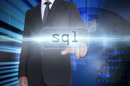sql: The word sql and businessman pointing against digital earth background