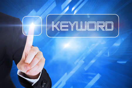 keyword: Businesswomans finger touching keyword button against abstract technology background LANG_EVOIMAGES