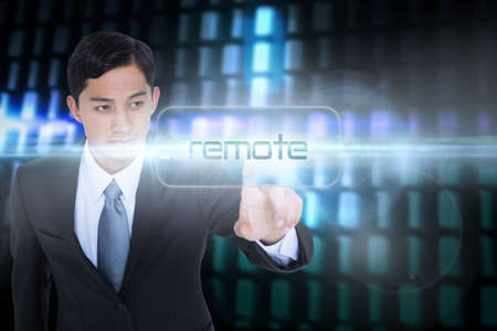 unsmiling: The word remote and unsmiling asian businessman pointing against glowing codes on black background
