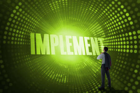 implement: The word implement and businessman holding his jacket against green pixel spiral LANG_EVOIMAGES