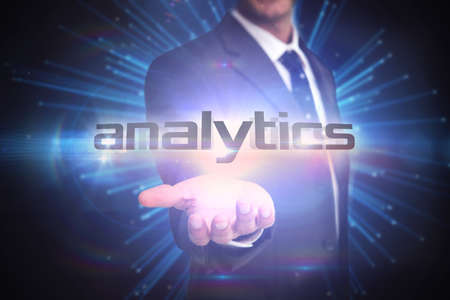 against abstract: The word analytics and businessman presenting against abstract technology background