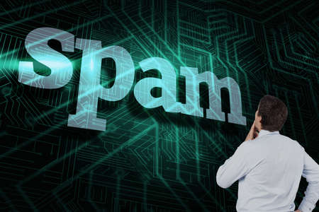 unsolicited: The word spam and thinking businessman touching his chin against green and black circuit board LANG_EVOIMAGES