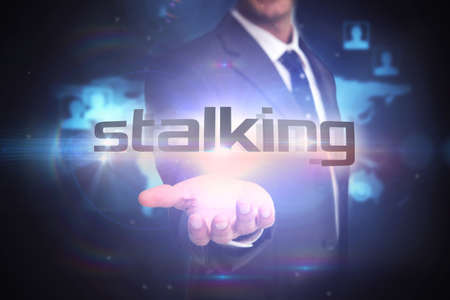 stalking: The word stalking and businessman presenting against futuristic technology interface
