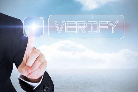 verify: Businesswomans finger touching verify button against cloudy sky background LANG_EVOIMAGES