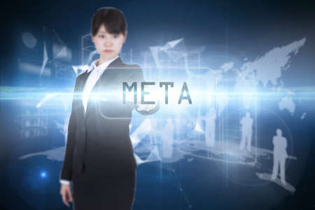 meta: The word meta and focused businesswoman pointing against glowing technological background