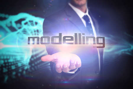 against abstract: The word modelling and businessman presenting against abstract blue glowing black background