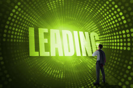 leading: The word leading and businessman holding his jacket against green pixel spiral