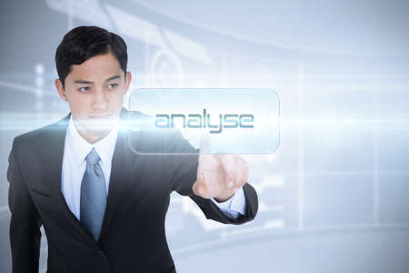 unsmiling: The word analyse and unsmiling asian businessman pointing against futuristic technology interface