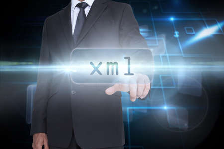xml: The word xml and businessman pointing against black background with shiny squares LANG_EVOIMAGES