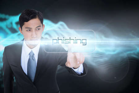 scamming: The word phishing and unsmiling asian businessman pointing against abstract blue glowing black background LANG_EVOIMAGES