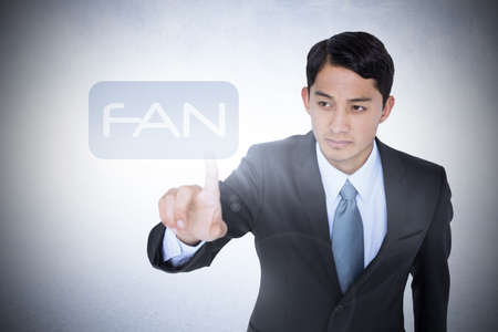 unsmiling: The word fan and unsmiling asian businessman pointing against white wall