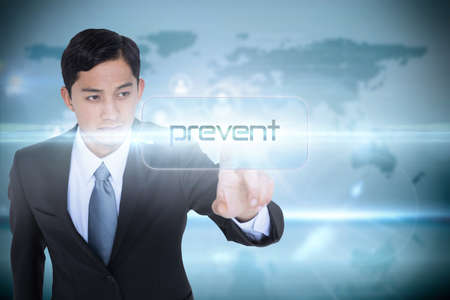 unsmiling: The word prevent and unsmiling asian businessman pointing against global interface