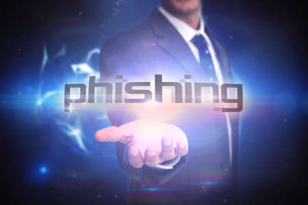 scamming: The word phishing and businessman presenting against glowing technological background LANG_EVOIMAGES