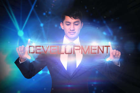 unsmiling: The word development and unsmiling businessman holding against glowing swirl on black background