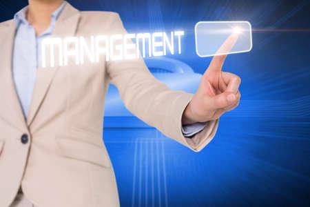 lock  futuristic: Businesswomans finger touching management button against lock on futuristic blue background