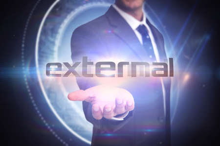 black professional: The word external and businessman presenting against black background with glowing circle