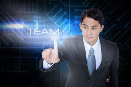 unsmiling: The word team and unsmiling asian businessman pointing against futuristic black and blue background