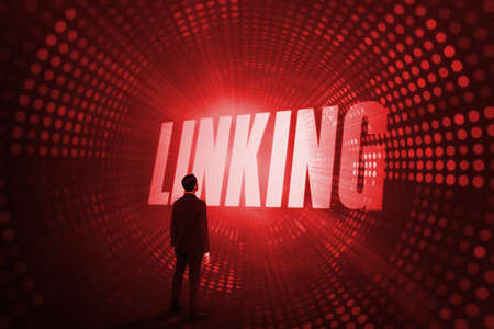 linking: The word linking and asian businessman against red pixel spiral LANG_EVOIMAGES