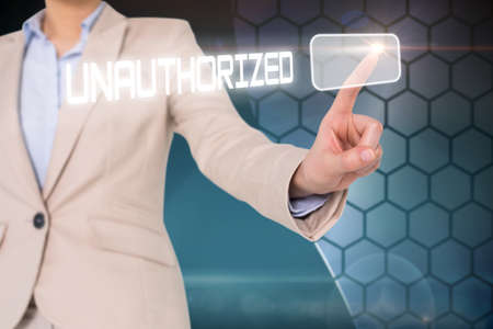 unauthorized: Businesswomans finger touching unauthorized button against shiny white hexagons