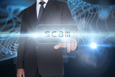 against abstract: The word scam and businessman pointing against abstract glowing black background